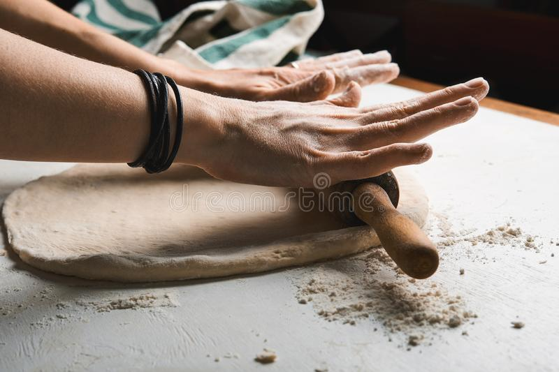 Dough and hands royalty free stock images