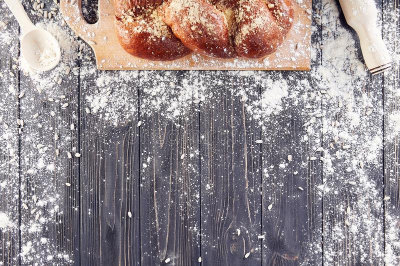 Dough preparation for bread, pizza, food flat lay on kitchen table. Working with flour, eggs, raisins, seeds or bakery cooking. royalty free stock images