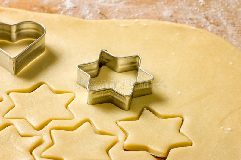 Dough and some cookie cutters stock photos