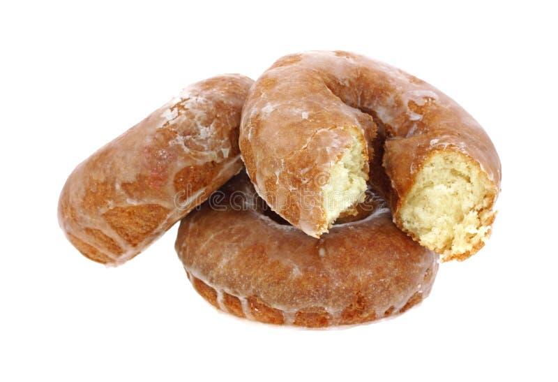 doughnut δαγκωμάτων που βερνικώνεται γενναιόδωρος στοκ φωτογραφίες με δικαίωμα ελεύθερης χρήσης