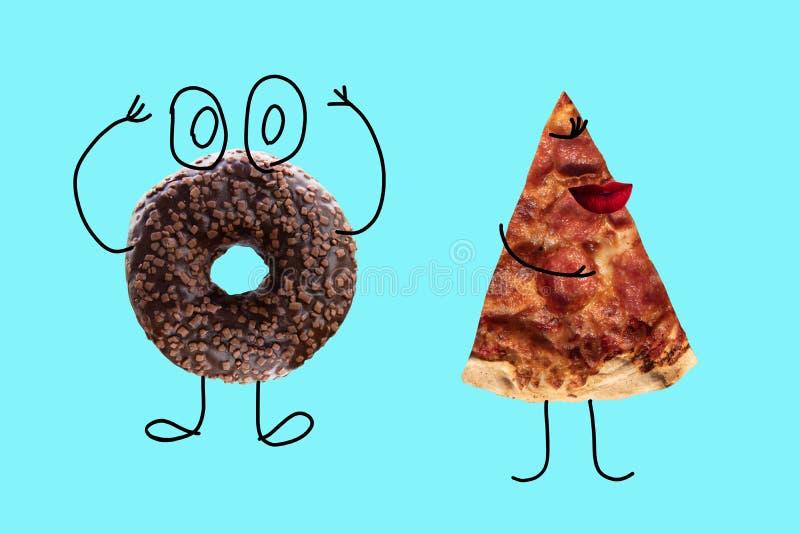 Doughnut και πίτσα σοκολάτας στο μπλε υπόβαθρο στοκ φωτογραφία