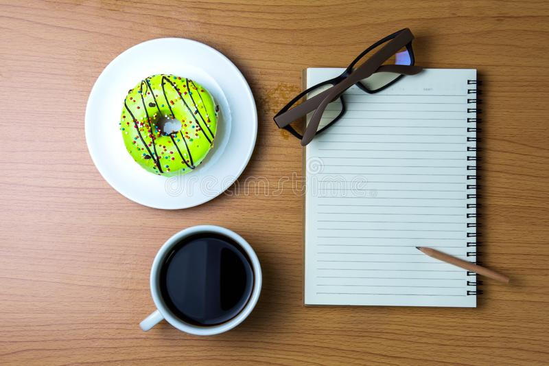Doughnut and coffee for work. royalty free stock image