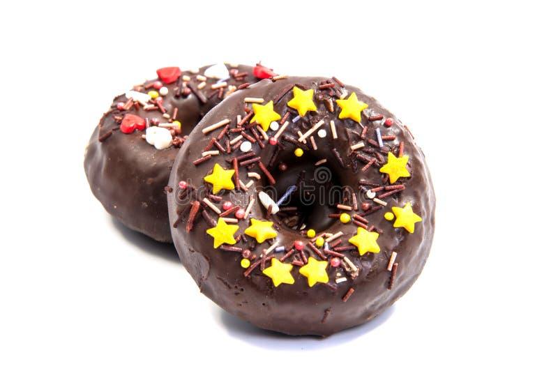 Doughnut of doughnut op wit stock afbeeldingen