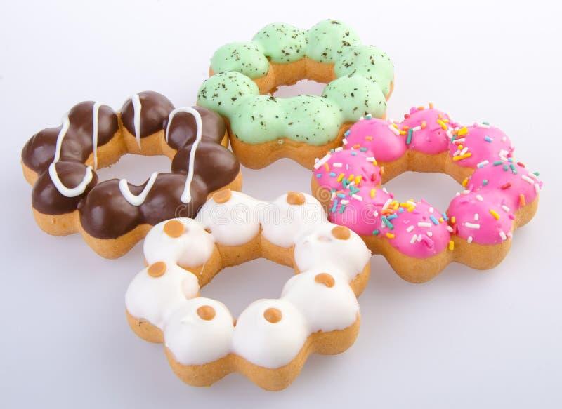 Doughnut, Kleurrijke Donuts op achtergrond stock afbeeldingen