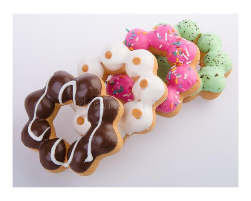 Doughnut, Kleurrijke Donuts op achtergrond stock foto