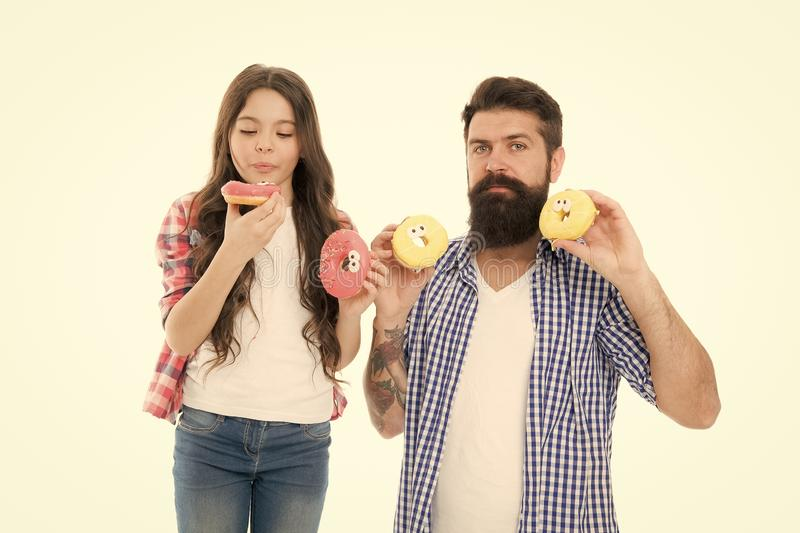 Doughnut lover. Best day ever. That is just amazing. fathers day. childrens day. family bonds. having fun. father and stock photos