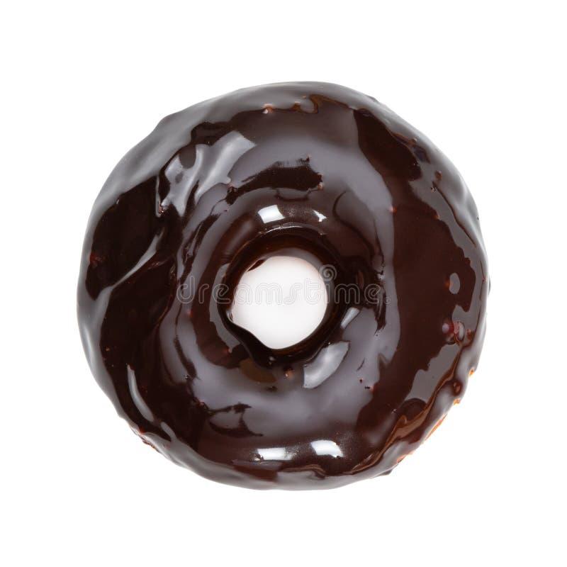 Doughnut met de glanzende die glans van de spiegelchocolade op wit wordt ge?soleerd royalty-vrije stock afbeelding