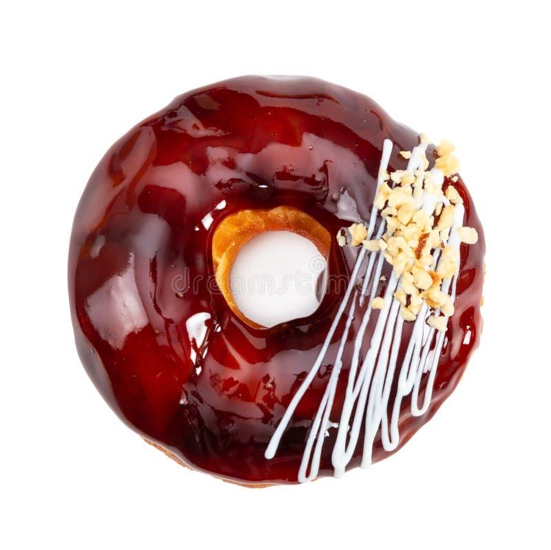 Doughnut met de glanzende die glans van de spiegelkaramel op wit wordt ge?soleerd royalty-vrije stock afbeeldingen