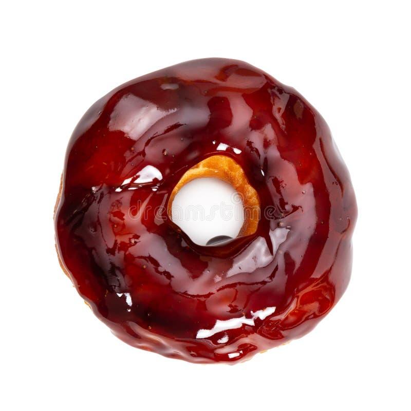 Doughnut met de glanzende die glans van de spiegelkaramel op wit wordt ge?soleerd stock afbeelding