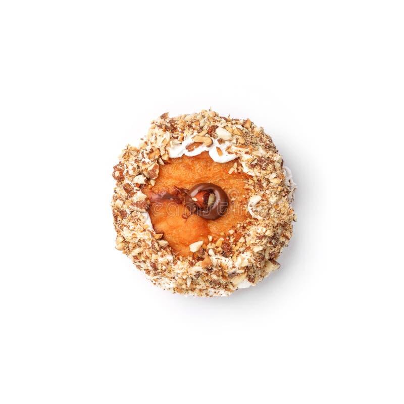 Doughnut met room en hazelnootkern Hoogste mening Geïsoleerd beeld royalty-vrije stock foto