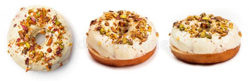Doughnut met witte die room en hazelnootkern, op witte achtergrond wordt geïsoleerd Mening vanuit drie verschillende invalshoeken royalty-vrije stock foto