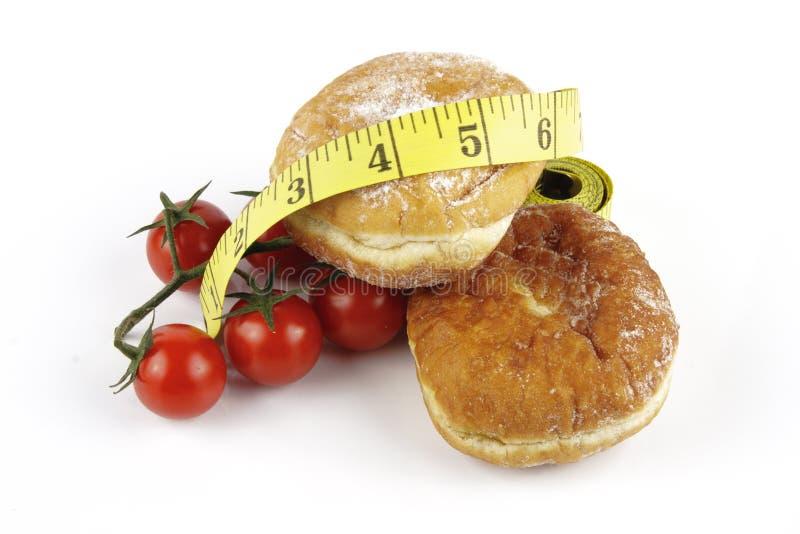 doughnuts ντομάτες ταινιών μέτρου στοκ εικόνα