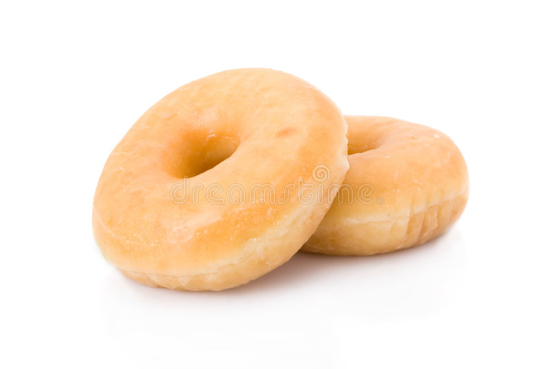 Doughnuts or donuts isolated on white royalty free stock image