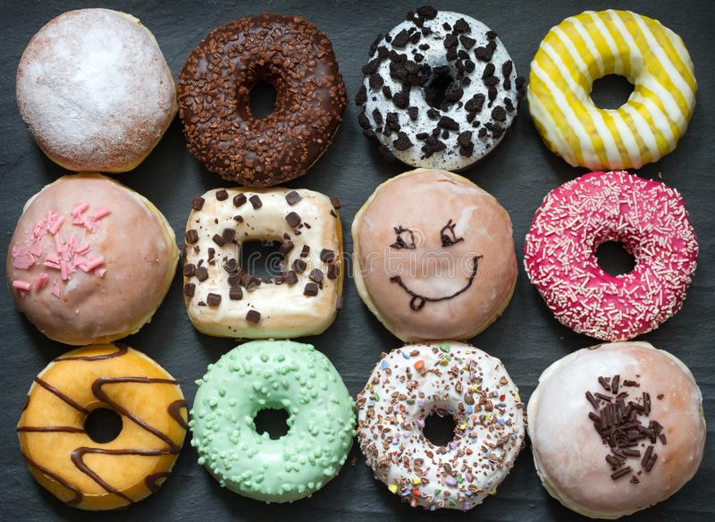 Doughnuts donuts various types of cakes abstract fat thursday concept. Closeup royalty free stock images