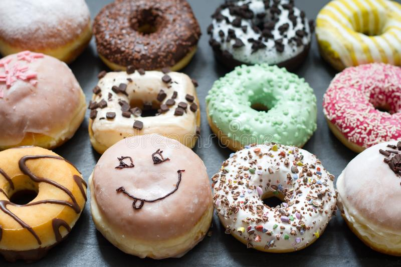 Doughnuts donuts various types of cakes abstract fat thursday concept. Closeup stock images