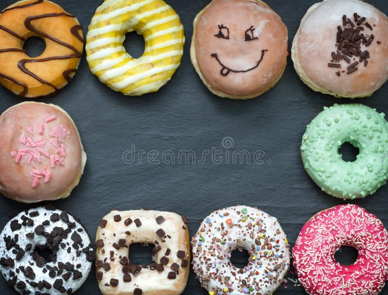 Doughnuts donuts various types of cakes abstract fat thursday frame concept. Closeup stock photography