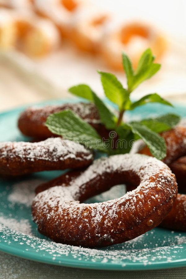 Doughnuts with icing sugar. Tasty doughnuts with icing sugar decorated mint royalty free stock photos