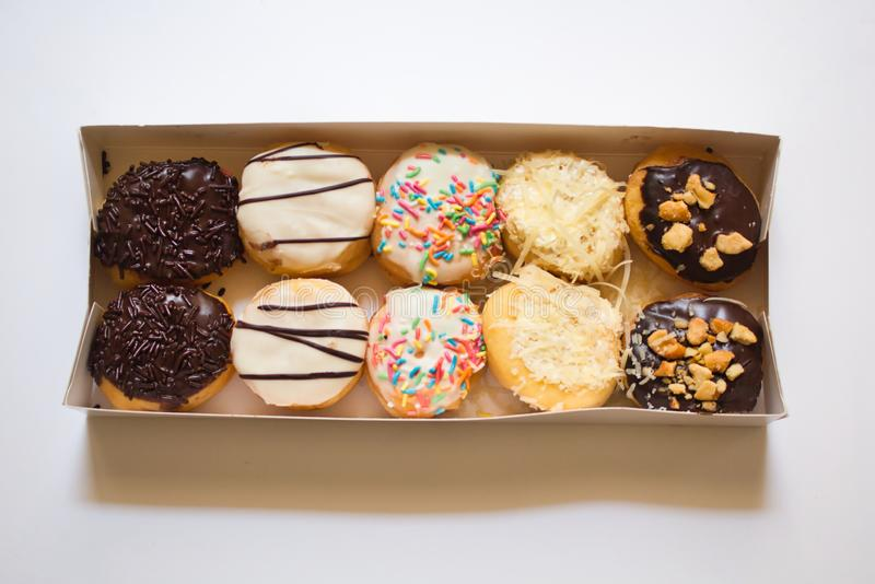 Doughnuts in various flavors and toppings royalty free stock photos