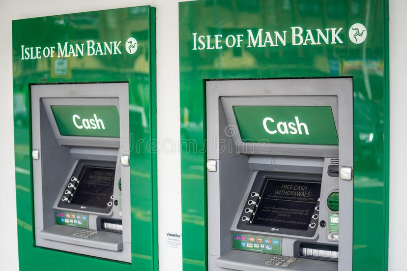 Douglas, Isle of Man, June 16, 2019. Cash machines.The Isle of Man Bank is a bank in the British Crown dependency of the Isle of. Douglas, Isle of Man, June 16 royalty free stock image
