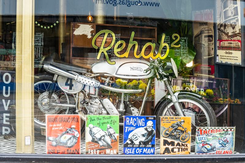 Douglas, Isle of Man, June 16, 2019. The motorcycle in a show-window of shop.  royalty free stock photo