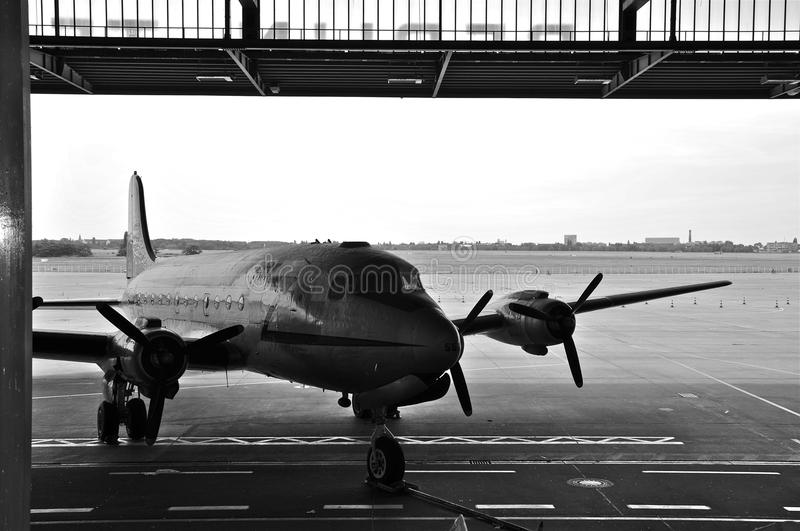 Douglas Skymaster in the boarding Area of Historic Berlin Tempelhof Airport; B&W. A Classic Douglas C-54, as used in the Berlin Airlift, on the Tarmac of royalty free stock photos