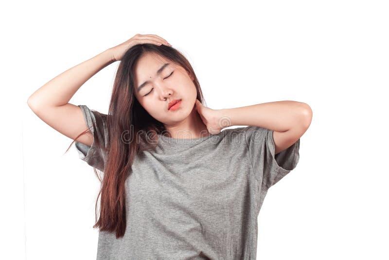 Douleur cervicale de sentiment de femme, massant les muscles tendus, les maux et les douleurs image stock