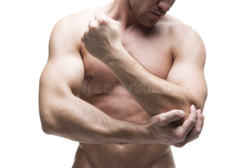 Douleur dans le coude Fuselage mâle musculaire D'isolement sur le fond blanc photos libres de droits