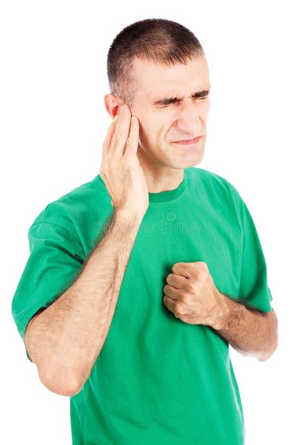 Douleur de sensation d'homme dans l'oreille photo libre de droits
