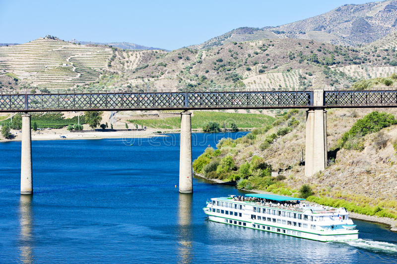 Douro Valley, Portugal. Railway viaduct and cruise ship in Pocinho, Douro Valley, Portugal stock photo