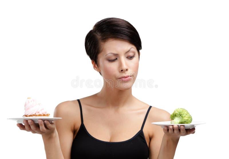 Douter entre la tarte et le légume photos stock