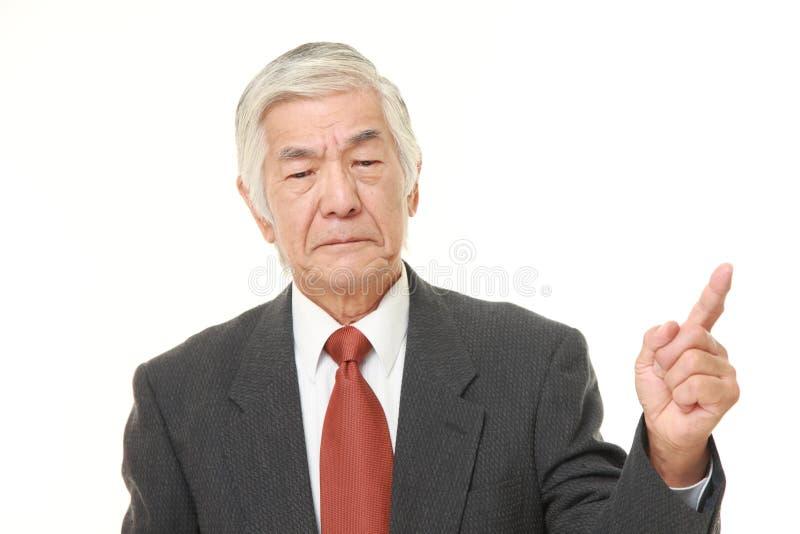 Douter japonais sup?rieur d'homme d'affaires photo libre de droits