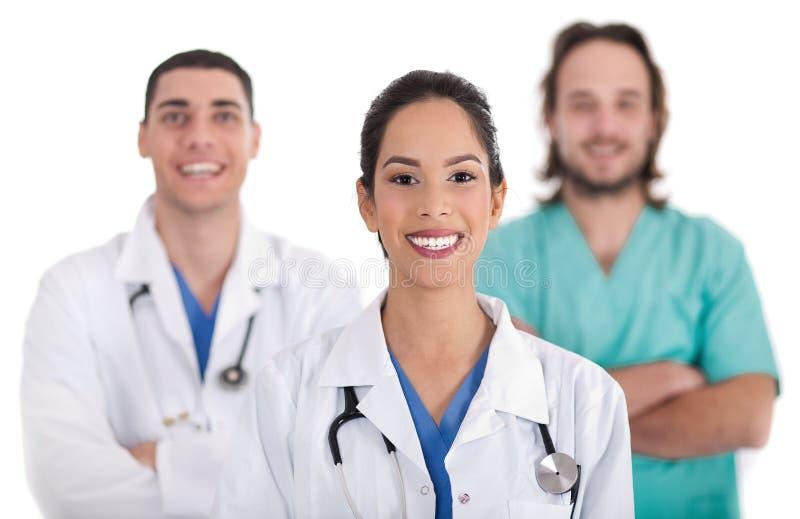 Doutor étnico com colegas imagens de stock royalty free