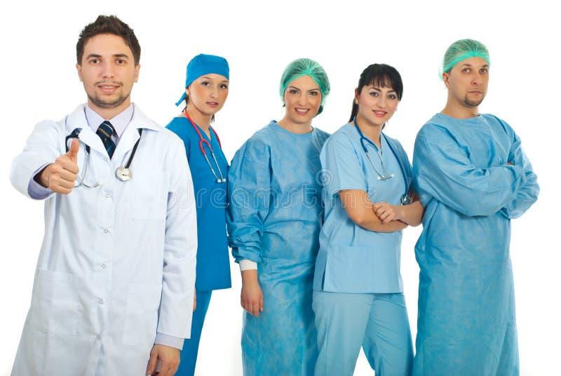 Doutor bem sucedido e sua equipe fotos de stock