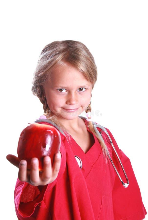 Doutor bonito da menina com maçã foto de stock royalty free