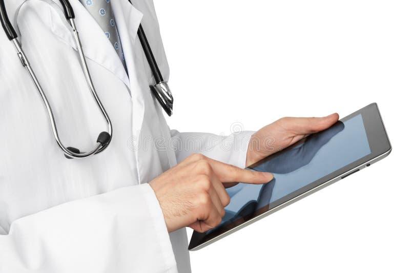 Doutor com computador da tabuleta fotos de stock