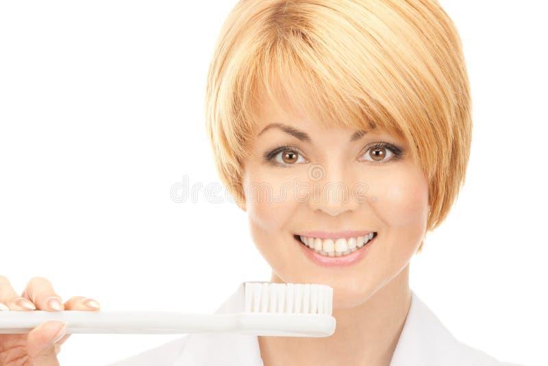 Doutor com escova de dentes foto de stock royalty free