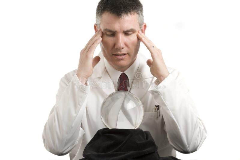 Doutor com esfera de cristal imagens de stock royalty free