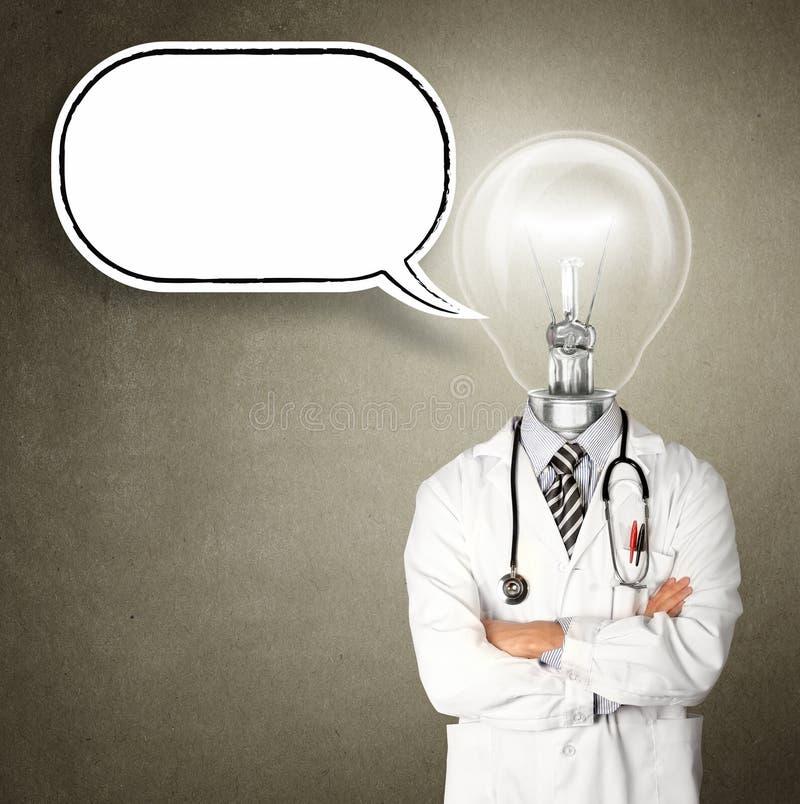 Doutor com lâmpada-cabeça foto de stock