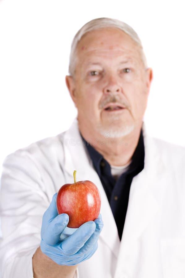 Doutor com maçã imagens de stock royalty free