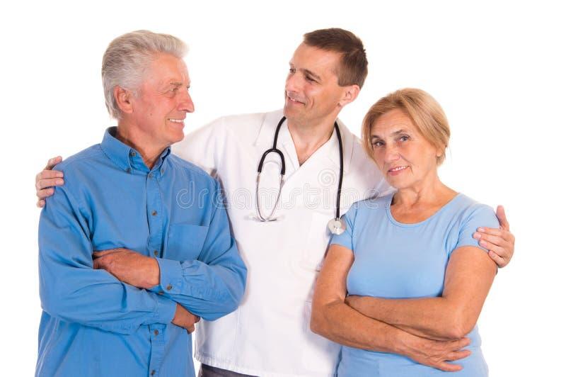 doutor com pacientes idosos fotografia de stock royalty free