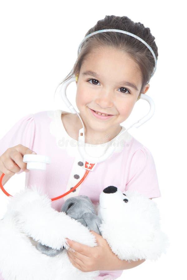 Doutor da menina com urso de peluche foto de stock