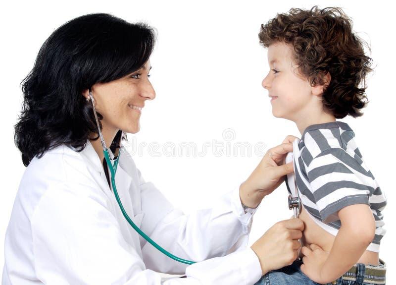 Doutor da senhora com uma criança fotografia de stock