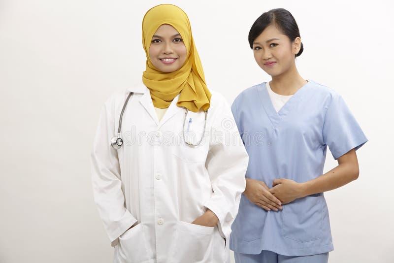 Doutor e enfermeira fotografia de stock royalty free
