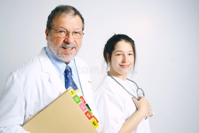 Doutor e enfermeira   foto de stock