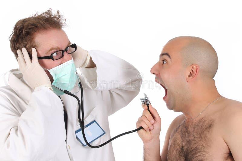 Doutor e paciente engraçados imagens de stock royalty free