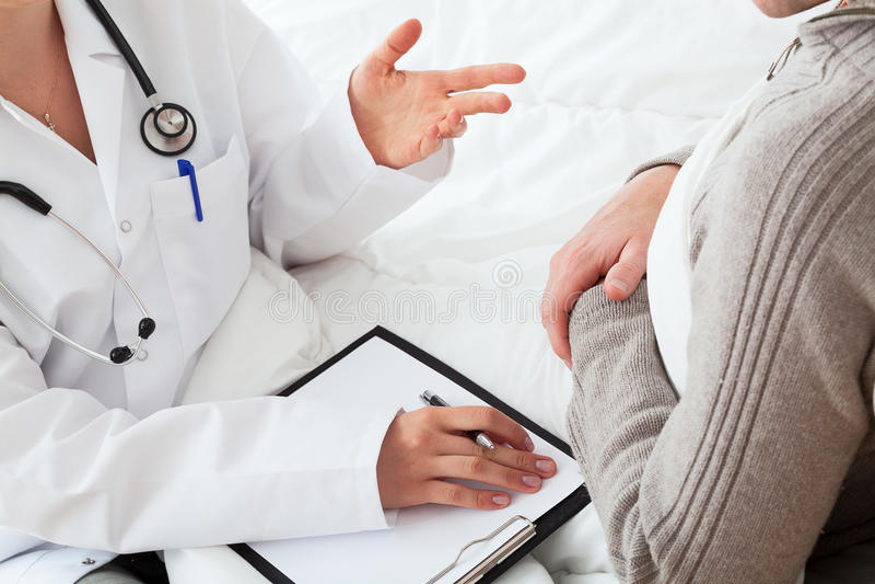 Doutor e um paciente imagem de stock