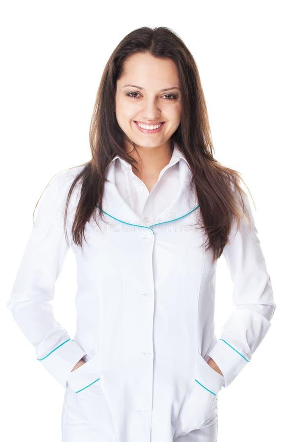Doutor fêmea de sorriso dos jovens isolado no fundo branco imagens de stock