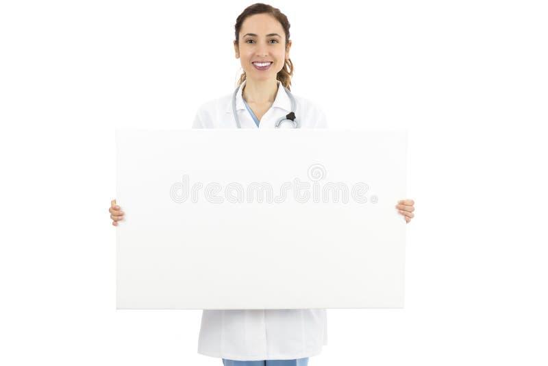 Doutor fêmea que guarda uma bandeira vazia da propaganda imagem de stock
