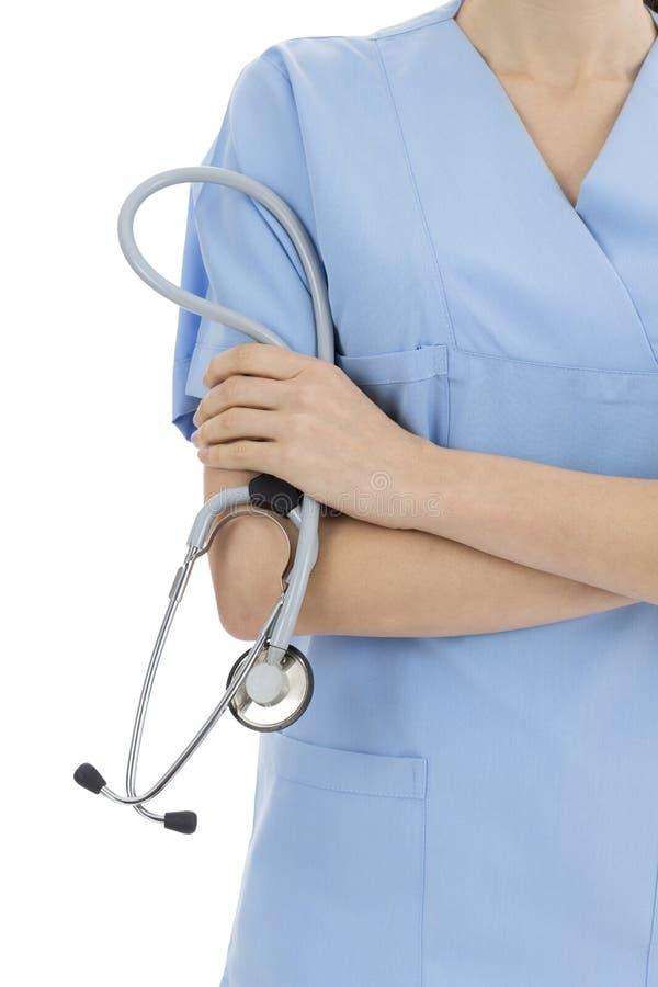Doutor fêmea que guardara um estetoscópio fotografia de stock