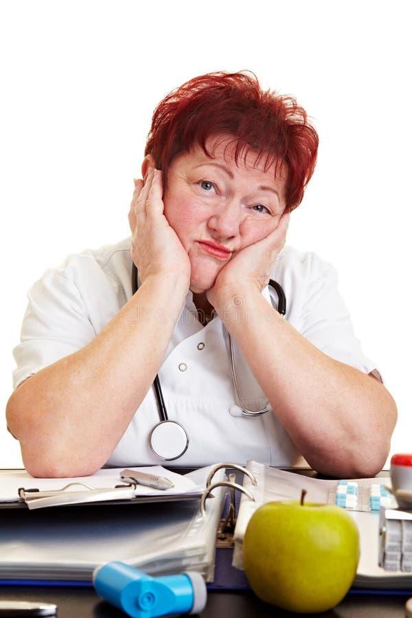 Doutor fêmea triste fotos de stock